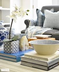 3 ways to style your coffee table or ottoman