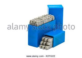 set of metal stamp number punch in blue plastic box isolated on