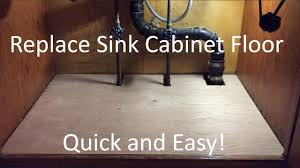 Does Flooring Go Under Cabinets Replace Sink Cabinet Floor Youtube