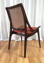 four cane back walnut dining chairs by richard thompson for glenn