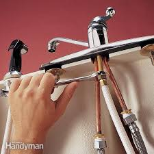 how to replace a kitchen sink faucet replace a sink sprayer and hose the family handyman