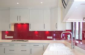 white kitchen red backsplash kitchen fitted with an opticolour