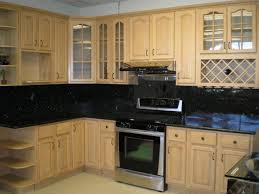 kitchen white cabinets with grey granite backsplash with white