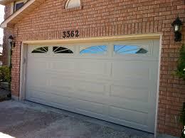 jen weld garage doors garage doors clopay value series ft x non insulated solid almond