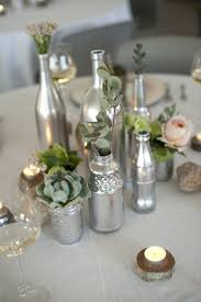 silver wine bottles empty glass bottles fill in as gorgeous wedding centerpieces