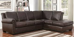 claire leather reversible sectional and ottoman claire costco