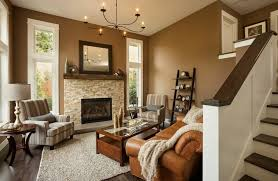 warm paint colors for living rooms contemporary living room with stone fireplace by lori brock