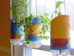 diy project self watering planters from reused materials