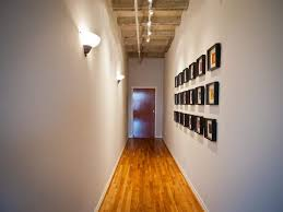 hallway decorated with framed square wall decor and illuminated