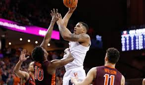 college hoops virginia moves to no 1 sports wire
