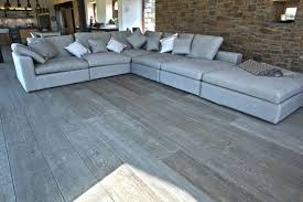 grey wood floor stain in living room with grey sofa flooring