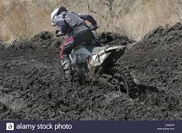 on road motocross bikes motocross bike in a race stuck in the mud stock photo royalty