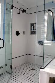 white ceramic bathroom wall tile black shower head glass partition