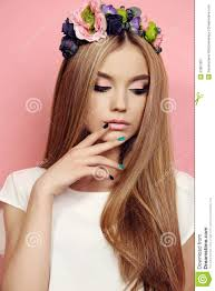 beautiful young with long straight hair with bright flower u0027s