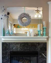 decorate over fireplace with mirror and wreath and candle holders