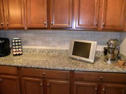 stone backsplashtacked with white cabinets glass andealer