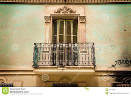 building elevation vintage balcony shutters and ornaments