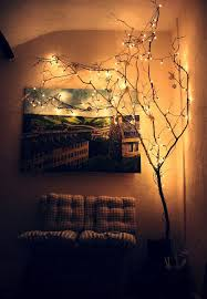 i like the idea of an indoor tree with white lights on it