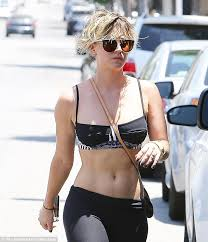 why did penny cut her hair kaley cuoco turns heads in black sports bra and yoga pants kaley