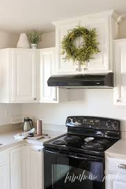top of kitchen cabinet greenery and easy greenery wreath farmhouse made