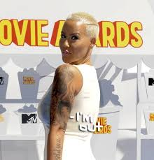 amber rose removes all traces of wiz khalifa by replacing the