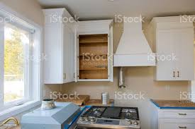 custom kitchen cabinets island custom kitchen cabinets in various stages of installation base for island in center stock photo image now