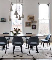 Eero Saarinen Executive Armchair Lindsey Adelman Making Light Of The Dark Side Dining Chairs