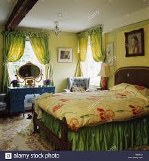 Pale Yellow Curtains by Pale Green Curtains On Window In Pale Yellow Bedroom With Floral