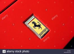 red ferrari red ferrari badge prancing horse black tricolor green white red