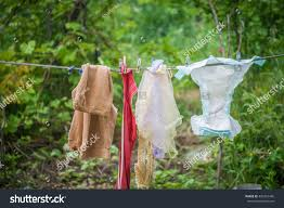 full diaper on clothes line baby stock photo 439297495 shutterstock