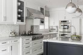 Marble Herringbone Tiles With Stainless Steel Cooktop Backsplash - Stainless steel cooktop backsplash