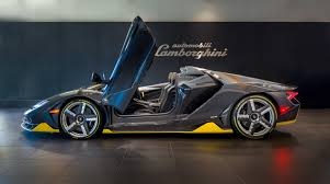 yellow and black lamborghini first lamborghini centenario roadster delivered worldwide