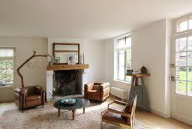 bedroom farmhouse family room with wood flooring plus area rug