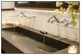 reported news on trough bathroom sink with two faucets discovered