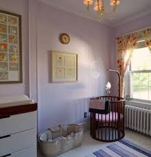 Baby Crib Round by Nursery Room With Pastel Walls And Brown Round Baby Crib Modern