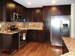 kitchen tile backsplash granite countertop oak colored cupboards