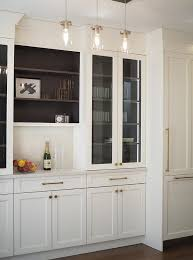 white kitchen cabinets with wood interior glass front kitchen bar display cabinets transitional