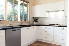 white kitchen cupboards black bench a htons style kitchen in melbourne how to recreate the look