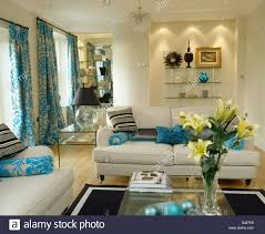 Living Room Recessed Lighting by Recessed Lighting Above Alcove Shelving In Cream Living Room With