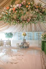 epicly beautiful wedding tent large floral chandelier fabric