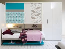white melamine wall bed built in wardrobe and bookshelf placed on