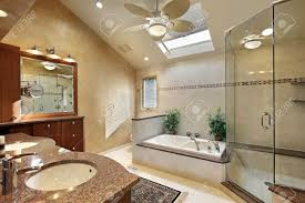 Modern Master Bathrooms by Modern Master Bath With Glass Shower And Skylight Stock Photo