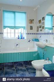 turquoise blind on window above turquoise tongue groove panelled