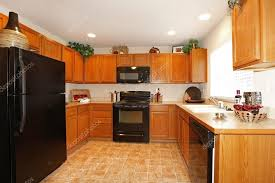 light brown kitchen cabinets with black appliances brown kitchen cabinets with black appliances 41893615