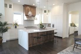 how to paint stained kitchen cabinets white our best tips for staining cabinets or re staining