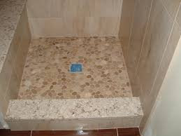 Shower Floor Mosaic Tiles by Custom Shower Base With Sliced River Stone Floor And Stone Curb