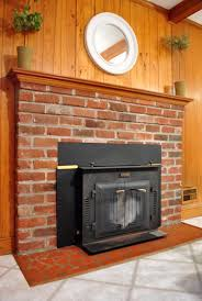 Remove Brick Fireplace by The Beginning Of A Fireplace Makeover Removing A Woodstove Insert