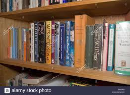 hardback books on a home library shelf include yeats shakespeare