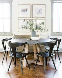round table sierra college a rustic round wood table surrounded by white eames dining chairs