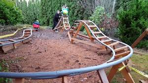 dad builds awesome rollercoaster ride for kids in the garden